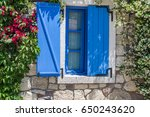 window with blue shutters and... | Shutterstock . vector #650243620