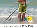 Male Surf Fisherman Baiting...