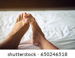 close up of couples feet in bed ... | Shutterstock . vector #650246518