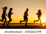 group of young people runs at... | Shutterstock . vector #650262199
