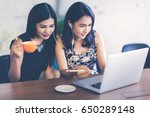 asian  woman working with her... | Shutterstock . vector #650289148