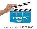 enter to win  clapperboard hand ... | Shutterstock . vector #650295460