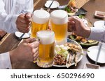 people are cheering with draft... | Shutterstock . vector #650296690