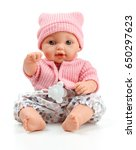 Small photo of Toy doll child, in pink blouse with pacifier on isolated background