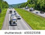 a steady mix of trucks  cars... | Shutterstock . vector #650325358