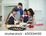 happy family preparing cookies... | Shutterstock . vector #650334430