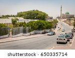 Small photo of HURA, ISRAEL. July 23, 2012. One of the main streets in the Negev Bedouin town Hura (Houra) with Yitzhak Rabin secondary school on the left, local mosque on the far right.