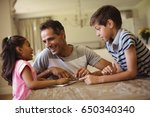 father and kids using digital... | Shutterstock . vector #650340340