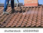 washing the roof with a high... | Shutterstock . vector #650344960