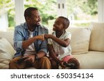 father and son fist bumping... | Shutterstock . vector #650354134