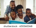 parents and kids sitting... | Shutterstock . vector #650360368