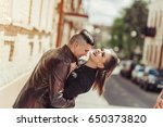 young stylish couple hugging... | Shutterstock . vector #650373820