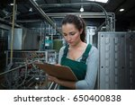 female factory worker... | Shutterstock . vector #650400838