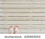 female legs with a pedicure and ... | Shutterstock . vector #650405053