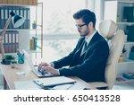 handsome brunette young man is... | Shutterstock . vector #650413528