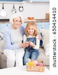 grandmother and child knitting... | Shutterstock . vector #650414410