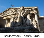 Facade with colonnade of the Palais Bourbon in Paris, seat of the french National Assembly, with the statue of Francois d