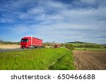 red trucks driving on the road... | Shutterstock . vector #650466688