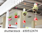 plant on a ceramic doll hanging. | Shutterstock . vector #650512474