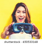 happy young woman using a... | Shutterstock . vector #650533168