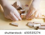 the girl stacking wooden block.  | Shutterstock . vector #650535274