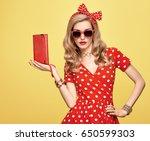 fashion woman in polka dot... | Shutterstock . vector #650599303
