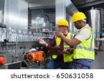 two factory workers discussing... | Shutterstock . vector #650631058