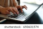 women's hands typing on computer