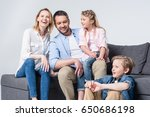 happy young family with two...   Shutterstock . vector #650686198