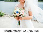 beautiful bouquet in hands of... | Shutterstock . vector #650702758