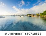 luxury yachts along grand baie... | Shutterstock . vector #650718598