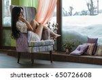 beautiful girl near the window... | Shutterstock . vector #650726608