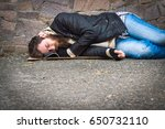 the homeless man is sleeping on ... | Shutterstock . vector #650732110