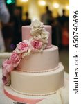 wedding cake in white and pink... | Shutterstock . vector #650740696