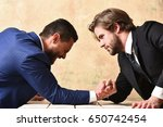 Small photo of loser man shouting, arm wrestling defeat and victory of businessman in suit