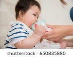babies drinking drinks | Shutterstock . vector #650835880