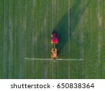 aerial view of the tractor... | Shutterstock . vector #650838364