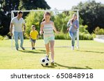happy family playing football... | Shutterstock . vector #650848918