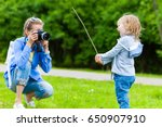 woman photographer takes... | Shutterstock . vector #650907910