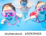 Little Kids Swimming  In Pool