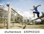 woman jumping over the hurdles... | Shutterstock . vector #650943103