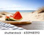 fresh juicy watermelon on desk... | Shutterstock . vector #650948593