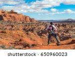 hiker standing on the mountain... | Shutterstock . vector #650960023