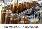 bottles in beverage production... | Shutterstock . vector #650993200