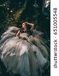 woman lying under a tree like... | Shutterstock . vector #651005548