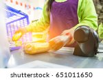 cashier in the supermarket  the ...   Shutterstock . vector #651011650