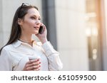 pensive woman telling by mobile | Shutterstock . vector #651059500