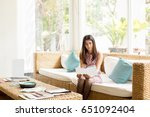serious young woman reading... | Shutterstock . vector #651092404
