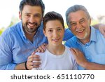 boy with father and grandfather | Shutterstock . vector #651110770
