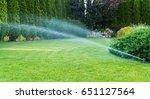 irrigation of the green grass... | Shutterstock . vector #651127564